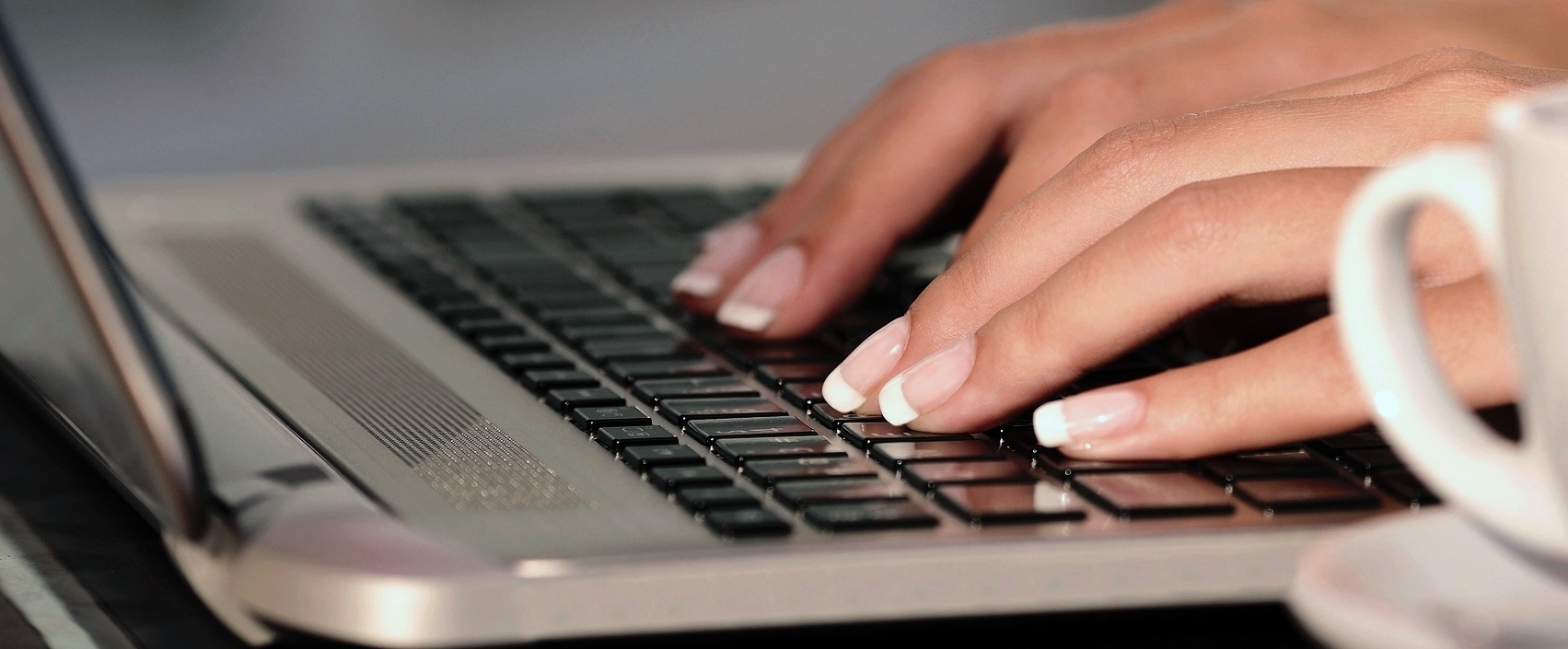 bigstock-Woman-Hands-Typing-In-A-Laptop-77151443 1703x705